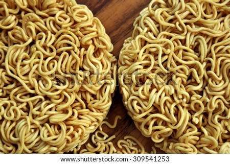Instant noodles on wooden plate