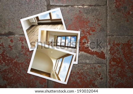 Instant photo frame showing renovated apartment on grunge background