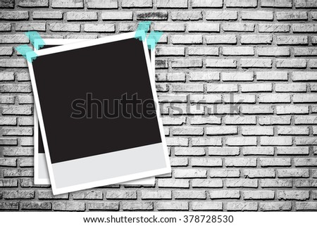Instant photo frames on grunge brick wall