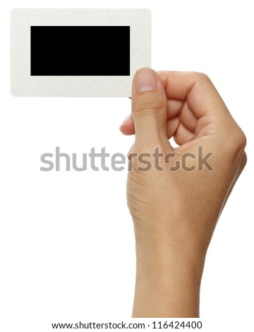 Instant photo in human hands as message blank board