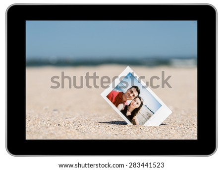 Instant Photo Of Young Couple On Beach On Modern Black Tablet In iPad Style