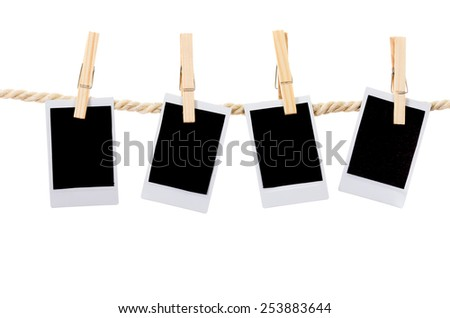 instant photographs hanging on a rope clothesline isolated on white - stock photo