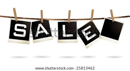 Instant photos hanging on a washing line with sale text - stock photo