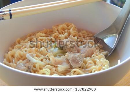 instant ramen noodles with chopsticks  - stock photo