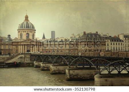 Institute de France in front of the Pont des Arts is a pedestrian bridge in Paris which crosses the River la Seine.  cross processed to look like an aged instant picture with texture. - stock photo