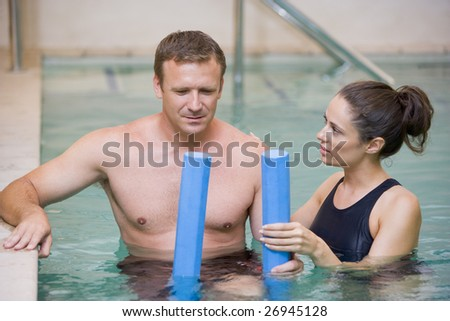 Instructor And Patient Undergoing Water Therapy - stock photo
