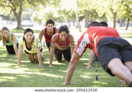 Instructor Running Fitness Boot Camp - stock photo
