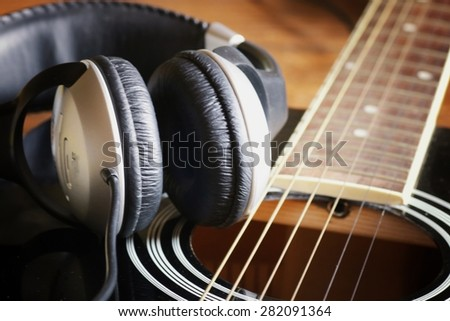 instrument guitar headphones and microphone - stock photo