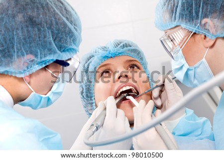 instruments against the backdrop of the open mouth - stock photo