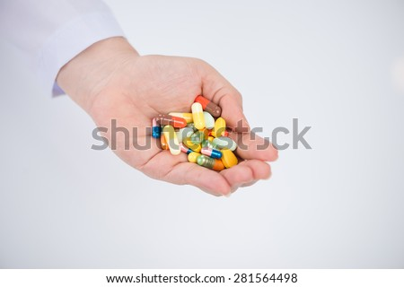 Insulated hand with pills. Medical concept - stock photo