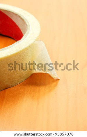 insulating tape on wood texture background - stock photo