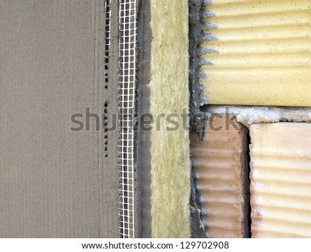 insulation on a brick wall with mineral wool and glue Network - stock photo