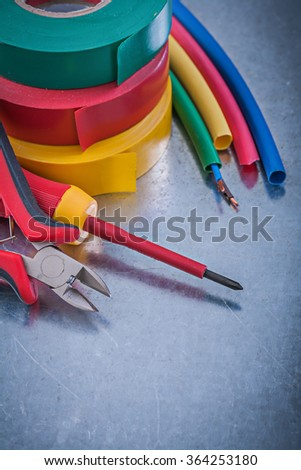 Insulation tapes cutting pliers electric wires insulated screwdriver construction concept. - stock photo