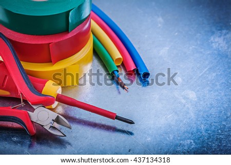 Insulation tapes nippers electric wires insulated screwdriver construction concept. - stock photo