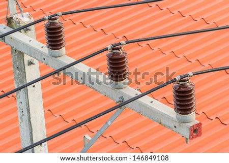 insulators of high voltage cable on a post - stock photo