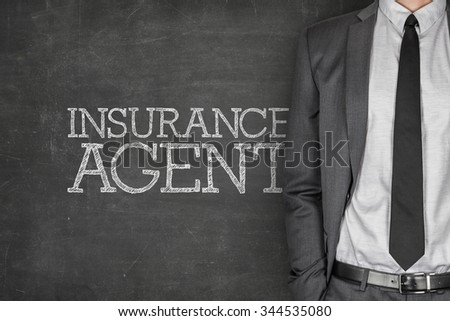 Insurance agent on blackboard with businessman in a suit on side - stock photo