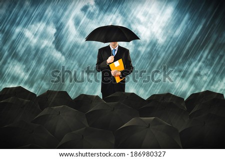 Insurance agents in heavy rain. Businessmen with umbrella gathering for protest.