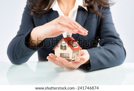 insurance and protect concept of your own home - stock photo