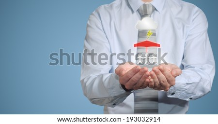 Insurance businessman hands protecting family from natural disaster - stock photo