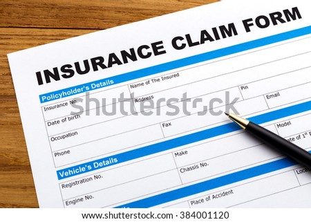Insurance claim form with pen