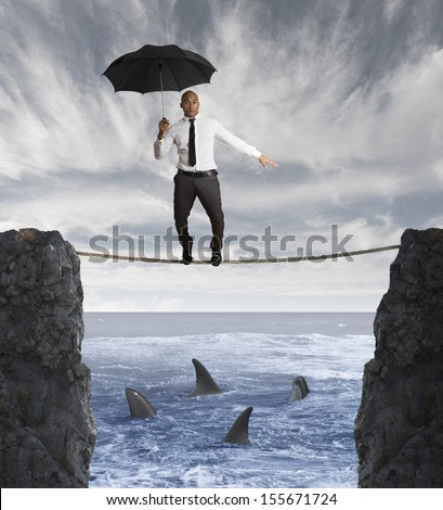 Insurance concept with businessman on a rope and shark in the sea - stock photo