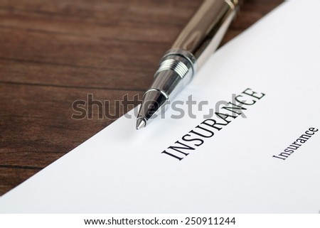 insurance  form on the desk in the office - stock photo
