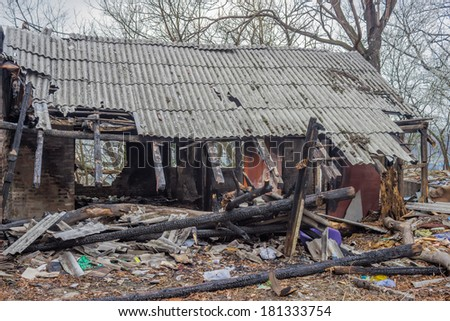 Insurance Fraud and Arson, home completely burned up in urban areas. - stock photo