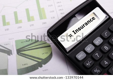 insurance or risk concept with calculator showing financial security - stock photo