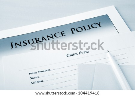 "Insurance policy and claim form, focus on words ""claim form"". - stock photo"