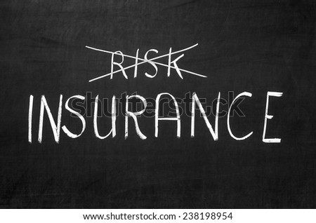 Insurance risk crossed out on the grey blackboard