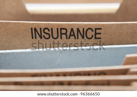 Insurance section tab in folding file. - stock photo