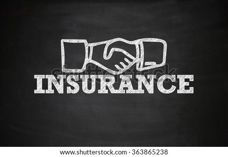 INSURANCE with check hand on Blackboard ,education concept, business concept , business idea - stock photo