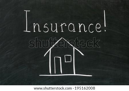 Insurance word handwritten with white chalk on a blackboard - stock photo