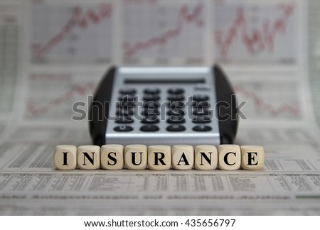 insurance word on a business newspaper
