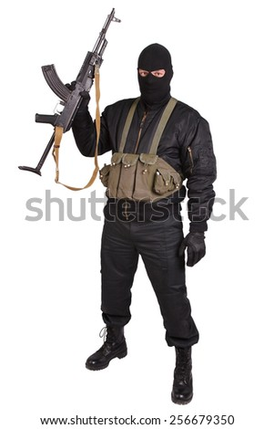 insurgent in black uniform and mask with kalashnikov isolated - stock photo