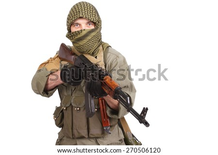 insurgent wearing keffiyeh with AK 47 gun isolated on white - stock photo