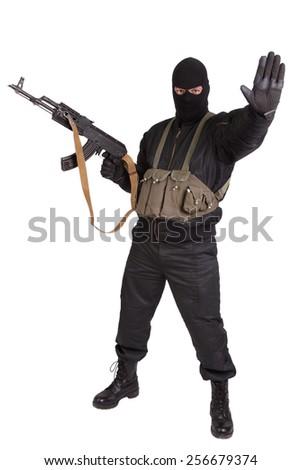 insurgent with kalashnikov isolated - stock photo