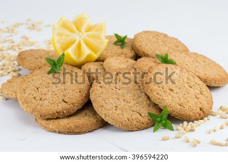 Integral biscuits decorated with lemon on white background - stock photo