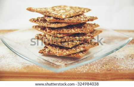 Integral biscuits plates with sesame and flax - stock photo