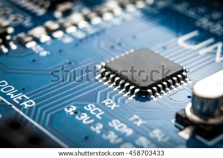 Integrated semiconductor microchip/ microprocessor on blue circuit board representative of the high tech industry and computer science