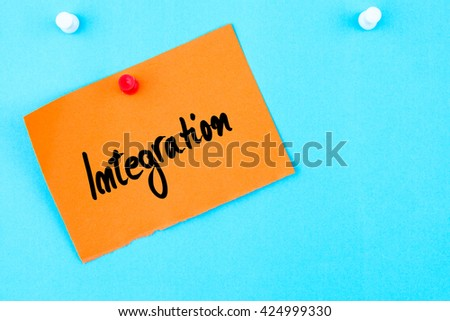 Integration  written on orange paper note pinned on cork board with white thumbtack, copy space available