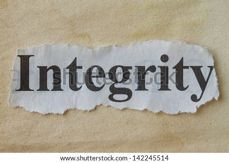 Integrity newspaper cutout with a vintage paper background. - stock photo