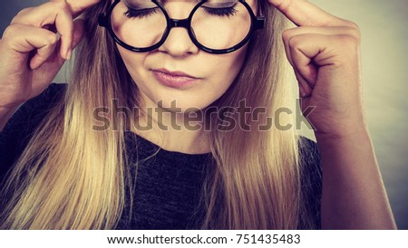 Intellectual expressions, being focused concept. Closeup of attractive woman wearing big eyeglasses thinking face expression