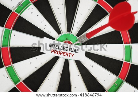 Intellectual property concept and a dart in a center of target - stock photo