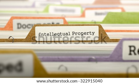 Intellectual Property - Folder Register Name in Directory. Colored, Blurred Image. Closeup View. - stock photo