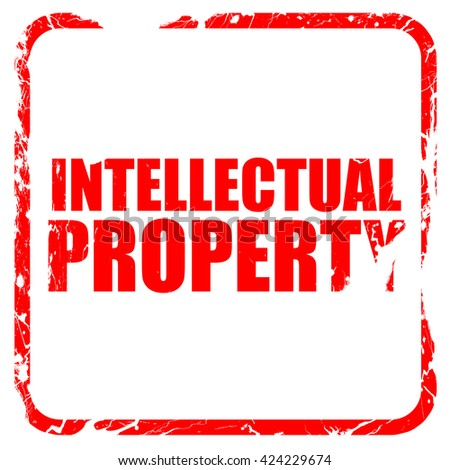 intellectual property, red rubber stamp with grunge edges - stock photo