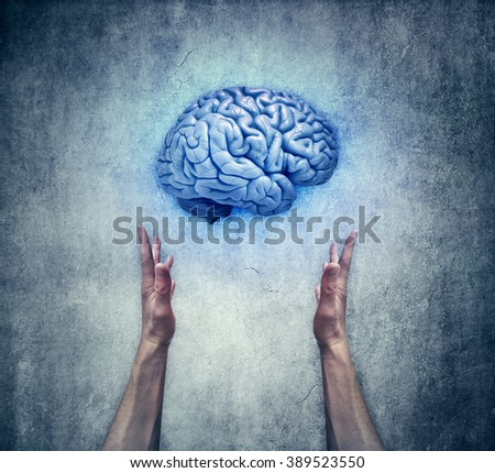 Intellectual protection. Closeup of two human hands holding a blue brain. Save intelligence and mental health concept - stock photo