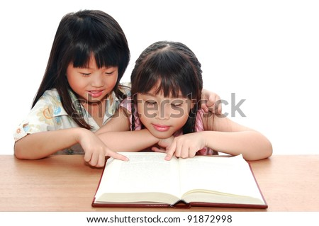 Intelligent little asian girl  reading a book - stock photo
