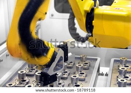 Intelligent Robotic arm at work - stock photo