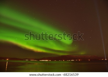 Intense Aurora borealis (northern lights)  and lots of stars, Iceland - stock photo